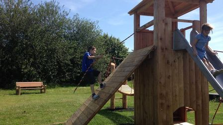 Children playing on the new equipment recently installed at Palgrave playground. Pictures Hannah Coo