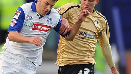 Alex Gilbey, right, chases Tranmere's Jake Kirby