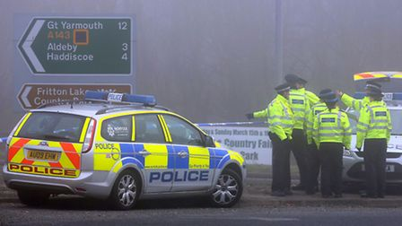 Police at a cordon on the A146.