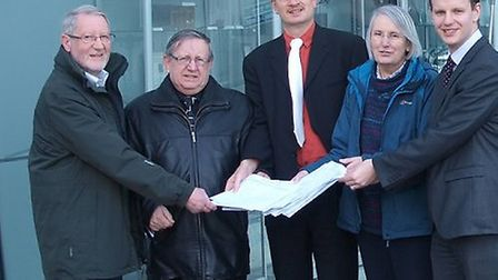 The petition against cuts to the number of full-time firefighters at Felixstowe is handed over at Su