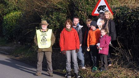 George Millins is pictured with volunteers in Folley Road, Great Waldingfield as they prepare to hel