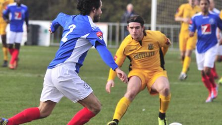 Maidstone's Luke Rooney (yellow) and Leiston's Blake Saker in action at Victory Road on Saturday. Ph