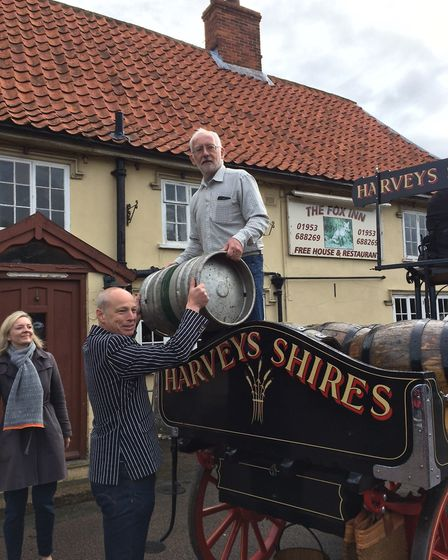 Peter Smith, director of the Garboldisham Fox Community Interest Company, lifting the cask off the