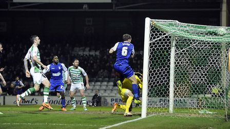 Christophe Berra scores at the far post to give Ipswich a first half lead at Yeovil