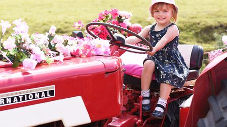 The 14th annual Pink Ladies Tractor Road Run for Cancer Research UK. Niamh Raines,3, enjoying the sp