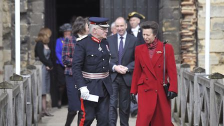 Princess Anne exits Colchester Castle with Lord Lieutenant Petre after receiving a tour by local off