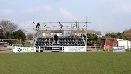 Volunteers working on placing the roof on the North Road stand