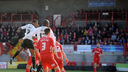Colchester's Sanchez Watt strikes the woodwork with this second half header at Crawley