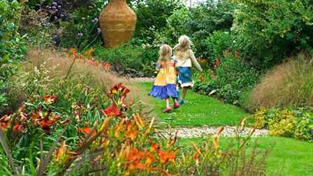 A picture from the past shows Flori and Tilly Watts having fun at TheLucy Redman Garden in Suffolk