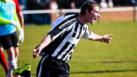 Roaring his side to victory: James Hubbard celebrates his first goal on Saturday