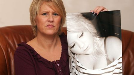 Melanie Webster is pictured holding a photo of her daughter Lily Webster who died during a trampolin