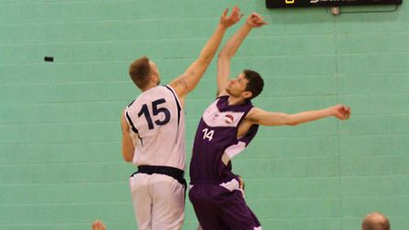 Ipswich's Leigh Greenan jumps for the tip-off at Loughborough