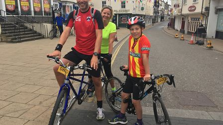 Chris and Lara Griffin-Sparrow ride out on a tandem for the first time with eleven-year-old son Will
