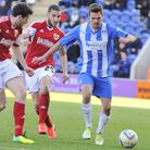 Colchester's Ryan Dickson gets the ball away from Bristol City's Brendan Moloney and Martin Paterson