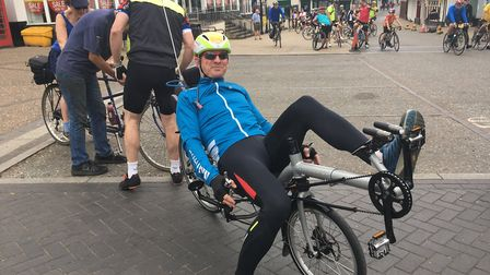 Andrew Scott riding his recumbent bike which is capable of speeds up to 40 miles and hour. Photo: Lu