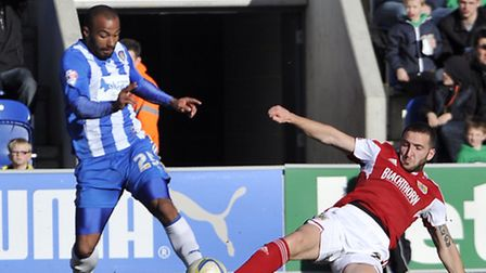 Colchester's Dominic Vose and Bristol City's Martin Paterson go for the ball during Saturday's 2-2 d