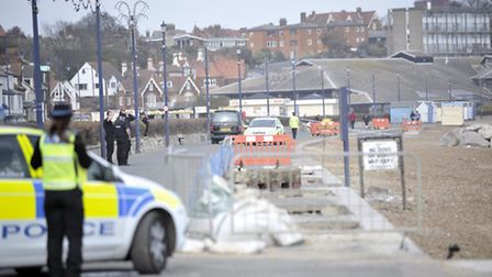 A black van carries away a body that washed up on a beach in Felixstowe across from Adventure Golf o