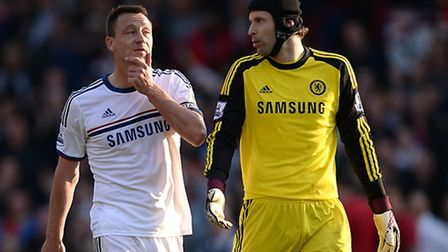 Chelsea goalkeeper Petr Cech (right) speaks with teammate John Terry after the final whistle of thei