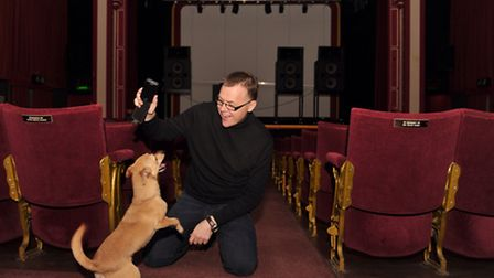 Wayne Burns with his dog Pip, the canine mobile phone detector at Leiston Film Theatre.