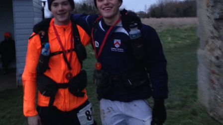 Oliver Robinson (left) and Rory Dowie (right) after a 45-mile race in Essex in preparation of the Ma