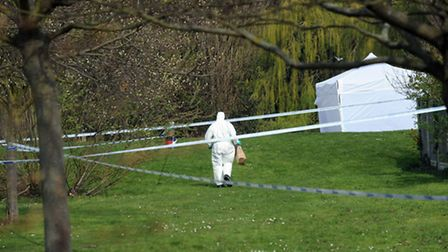 Police at the scene in Castle Park in Colchester after a body was discovered.
