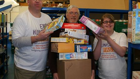 Glyn and Ambrin Williams loading up Phil Riley, co-ordinator at the East Suffolk FoodBank in Lowesto