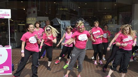Zumba ladies, along with their pink gorilla, workout in Ipswich Town Centre on Friday, 28 March to p