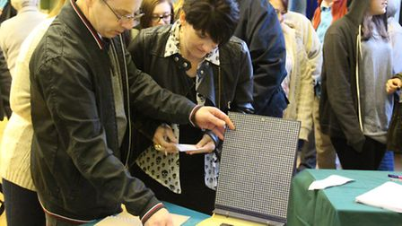 People look through school photos, punishment books, records and other memorabilia at the Orwell Hig