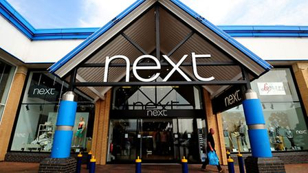 Next has reported annual profits of �695m.
