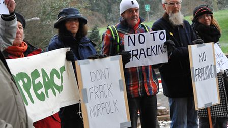 Campaigners from Greenpeace hold a demonstration outside County Hall in Norfolk