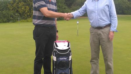 Winner Keith Hussey receives his trophy from Diss Golf Club president Peter Mendham. Picture: Diss G