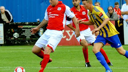Lee Townrow, left, in action for Needham against Romford