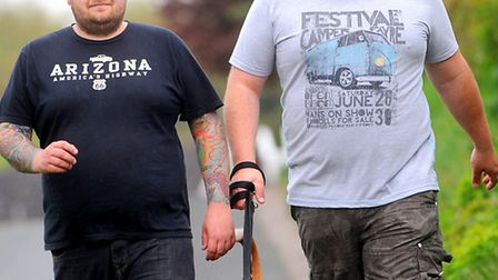 Dog owner Lewis Blythe, left, chartered a helicopter to search for his and his partner Gary Lee's do