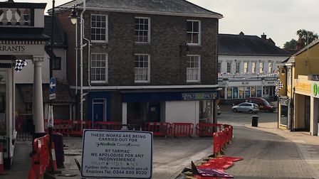 Work underway is underway in The Heritage Triangle in Diss to relay tiles. Photo: Lucy Begbie