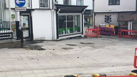 Work is underway in Diss to relay tiles in The Heritage Triangle. Photo:Lucy Begbie