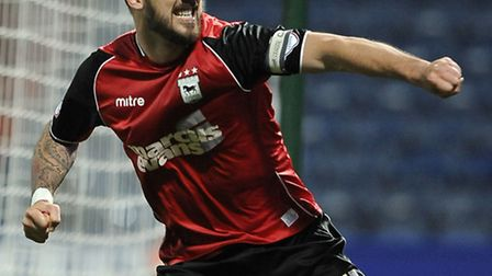 Luke Chambers with his customary winning celebration after the final whistle at Huddersfield