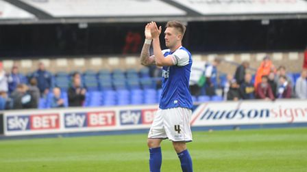 Match-winner Luke Chambers salutes Town fans at the end of the game.