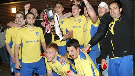 Adhara players celebrate with the Primary Cup