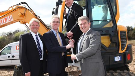 Government ministers Kris Hopkins (on digger) and Brandon Lewis (right), take part in turf-cutting