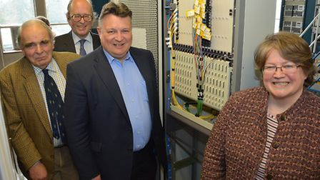 """Mark Bee and Therese Coffey at the new """"Head End"""" in Saxmundham watched by local district councillor"""