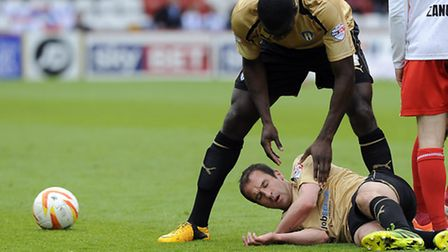 David Wright is stunned after a collision at Stevenage. He faces a late fitness test ahead of tomorr