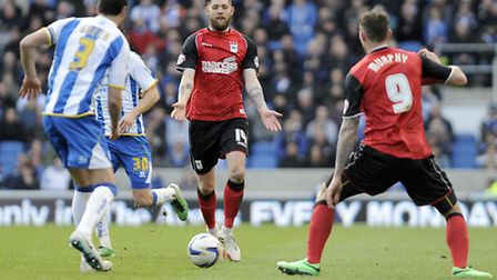 Back in the side: Anthony Wordsworth demands the ball at Brighton