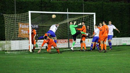 Goalmouth action from Diss Town's Norfolk Senior Cup exit at Fakenham Town. Photo: Tony Miles.