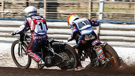 Witches guest Rene Bach (red helmet) is left little room by Peterboroughs Ryan Fisher in the opening