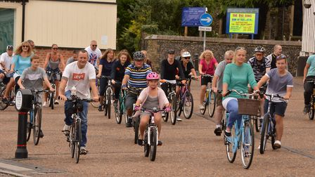 The charity fundraising bike ride in aid EAAA sets of across Diss market square: picture: Tracey All
