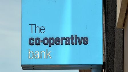 The Co-operative Bank has reported a �1.3 billion annual loss for 2013 and warned that 'legacy issue