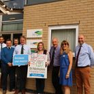 Frontier Agriculture hands over a donation of more than £2,000 to St Nicholas Hospice Care. Picture