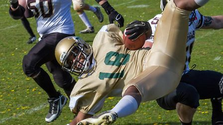 Bury Saints, in gold, play the Essex Spartans