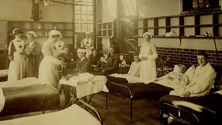 A busy day at the old grammar school in Woodbridge in the summer of 1914, transformed into a Red Cro