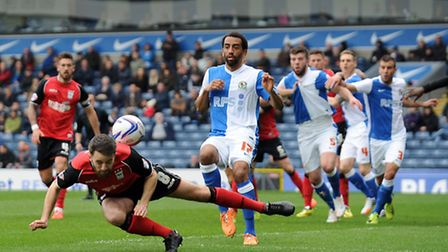 Cole Skuse ducks low to flick on a corner during the first half against Blackburn